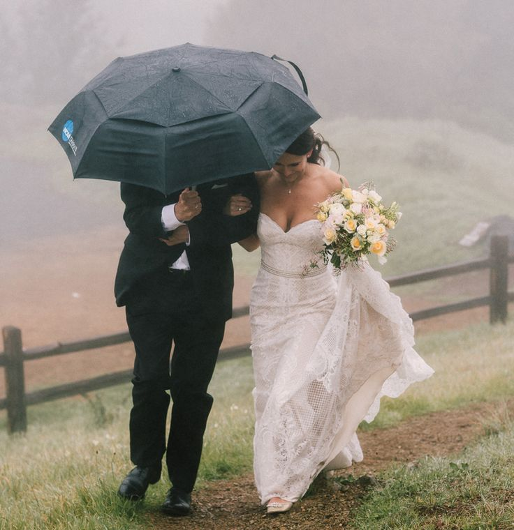 Rain on your wedding day is good luck! Clearly Kelly & Micah did not let it bother them at all. An outdoor wedding in Mill Valley complete with umbrellas. We loved making this blush bouquet. Photo by Arnau DuBois