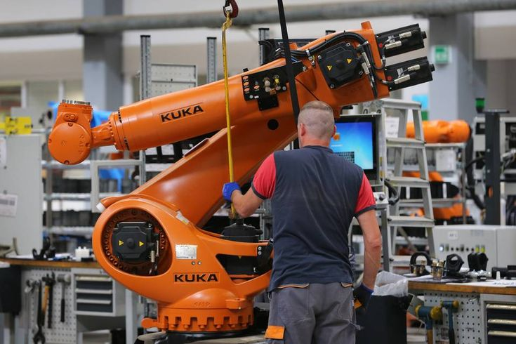 Robots are assembled in the production hall of robot manufacturer Kuka in…
