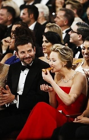 Jennifer Lawrence eating the pizza she was so happy to get at the Oscars. Bradley's face though...