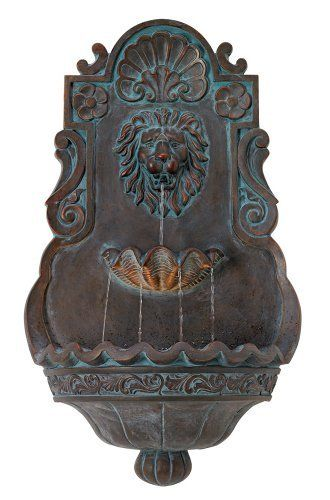 Lion head iron and faux stone indoor outdoor fountain water cascades from the mouth of