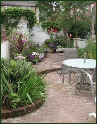 Courtyard garden with brick paving and raised beds