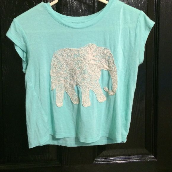 A Light blue shirt with a very detailed elephant A light blue shirt with a detailed elephant used little and perfect condition Cherokee Tops