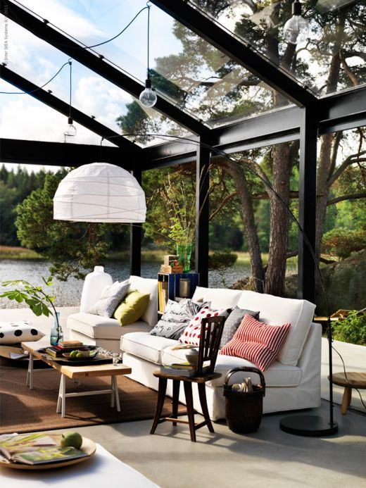 Beautifully designed conservatory with gorgeous view of a lake