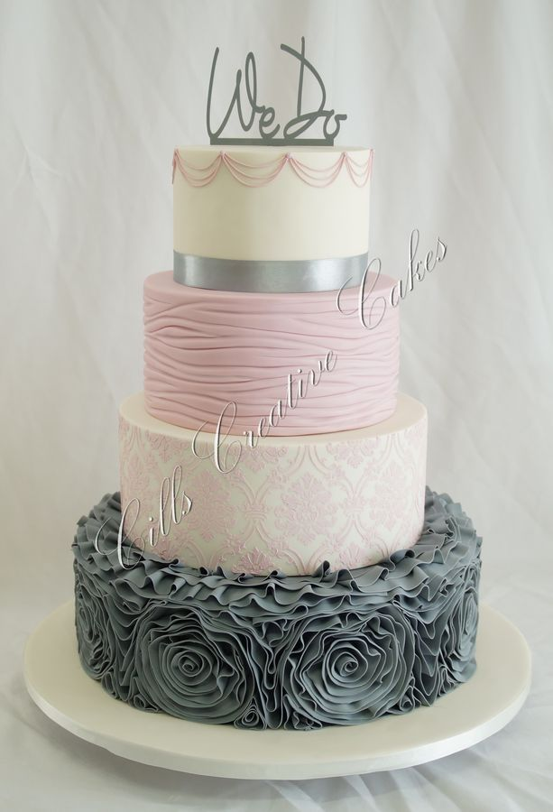 CilisCakes on Cake Central. I normally try and steer my clients away from grey on the cake because grey is not only are hard to see and needs special lighting, nobody wants to eat grey food because grey food is totally unappealing. This is an EXCELLENT way to work grey into your cake!!! Wonderful job, CilisCakes