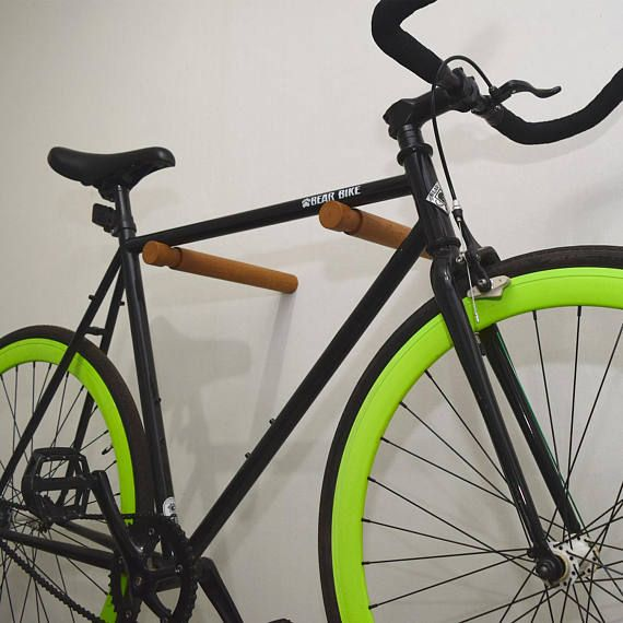 Minimalist bike rack is easy and stylish way to care your bike. Bicycle holder consists of two wood cylinders with a notch that securely and easily fit your bicycle. Bike rack is hand crafted from oak wood and finish with oil. The hangers can be used for all bike shapes and forms - you
