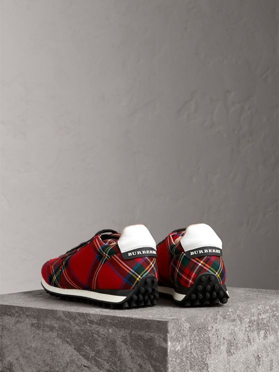 Modern Stewart Royal tartan wool trainers accented in smooth calf leather and House check. They are engineered with a comfortable cushioned cuff and specially moulded grip sole for a lighter step.