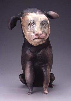 Susan Halls. Love how this human-faced dog figure slips past cute right without being outright creepy.