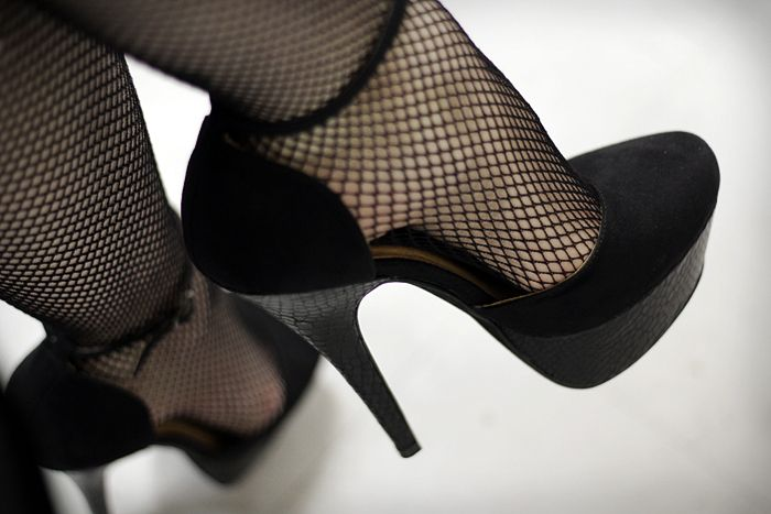 Fishnet stockings and platform pumps.