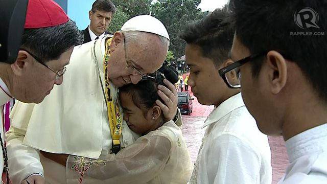 REFUGE. 12-year-old street kid Glyzelle Palomar gets a warm hug from the Pope. Tulay ng Kabataan Foundation.