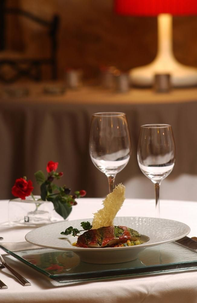 A plate of delicious food and accompanying wine served at La Villa Romaine #foodie #hotel #restaurant #fish #food #yum