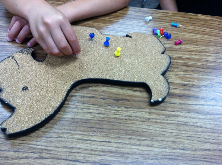"""Giving my sick corkboard dog his shots. New and improved with a Sharpie face!! Great for hand strengthening. The kids come up with some hilarious issues such as """"eye 'fections"""" lolol....Days of Our OT Lives"""