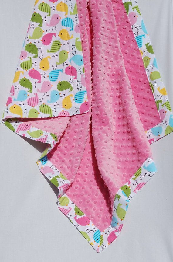 Cotton and minkee baby blanket.  Wonder if you could do this using iron-on seam binding...