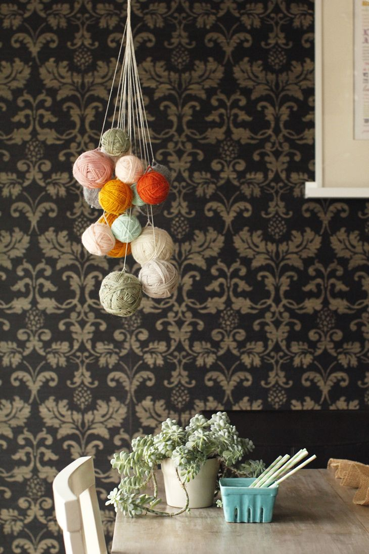 DIY: yarn chandelier  Pretty sure my cats would be swinging on this bitch in mere minutes. Maybe faster.