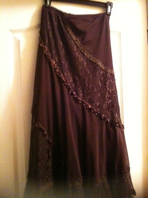 Brown lace & ribbon skirt. I have the same in black. This one is from  Delta Hospice Thrift. $6.00.
