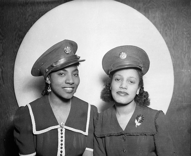 Playing Dress Up | c. 1942-45  Two African American women wearing U. S. Army caps, posed in front of circular background.    Photo Credit: Teenie Harris Archive 1920-1970 © Carnegie Museum of Art, Pittsburgh, PA