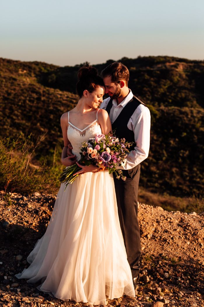A gorgeous mountain elopement styled shoot coordinated by Jen Events'. Photography by Taylor from TMinspired. See more stunning photos @intimateweddings.com #elopementstyledshoot