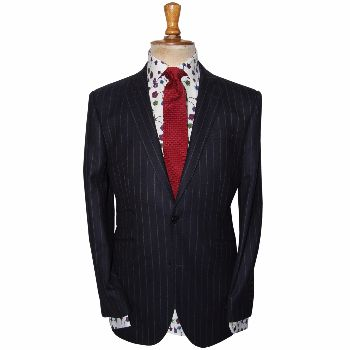 Gresham Blake Navy Single Breasted Chalk Stripe Suit: New as part of our Autumn Winter 2015 collection. A classic single breasted navy pinstripe suit.  -Single breasted -2 button fastening -Slim tailored fit -Gold floral lining (front panels only) -British woven cloth