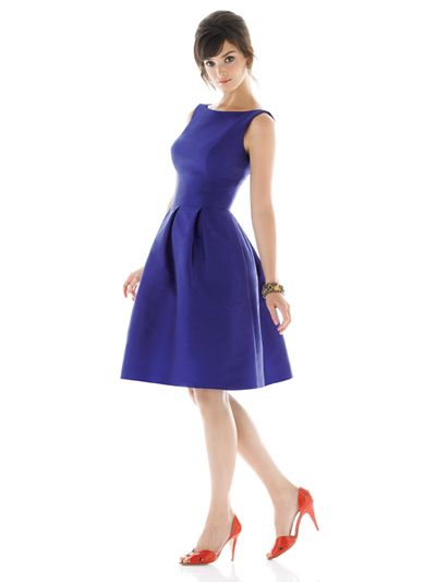 Blue 50s-style dress with orange heels