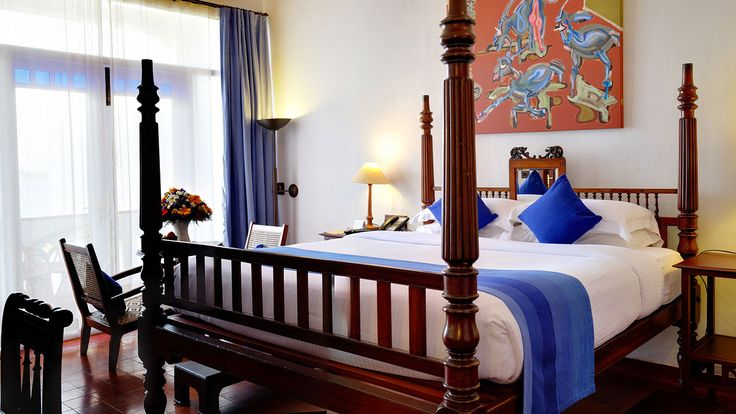 A view of the sea, the sound of the birds and the comfort of a high, antique bed.