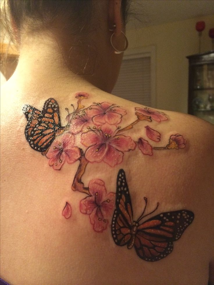 Monarch Butterfly and Cherry Blossoms  in honor of my mom who passed away from leukemia 23 years ago. The Cherry Blossoms  signify her short but beautiful life and the Monarchs Butterflies are for the orange that is the color of the ribbon that is used to show support of leukemia.