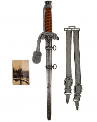 Army Officer's Dagger with Hangers by PUMA Solingen  This Army Officer's Dagger is in EXC++ condition with Hangers, Portepee and Photo of the Wearer. Model 1935. The total length is 40.5 cm. The Dagger has the maker mark on the blade: PUMA Solingen.