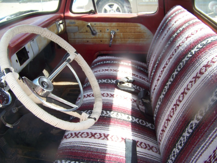 I made seat covers for my old ford truck out of falsa blankets. I still have a scrap left for if I want to make sun visor covers. The steering wheel treatment is actually a cotton clothesline.