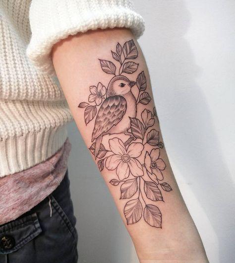 Forearm feminine bird tattoo by Irene Bogachuk