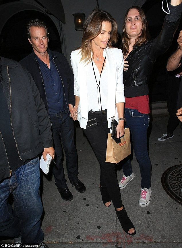 Chic and cheerful:Cindy Crawford showed that she can look equally as stunning while off-duty as she enjoyed a romantic date night with husband Randy Gerber at Craig's restaurant on Tuesday
