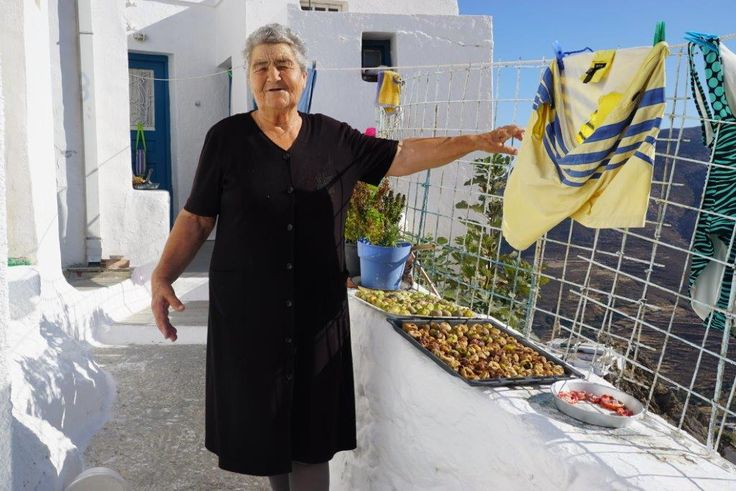 Mrs Dimitra and her dried figs and tomatoes. Serifos: Mountainous landscape, small lush valleys, whitewashed houses, sandy beaches & brilliant blue waters. #FiveStarGreece #LuxuryVillas #HolidayMatchmakers