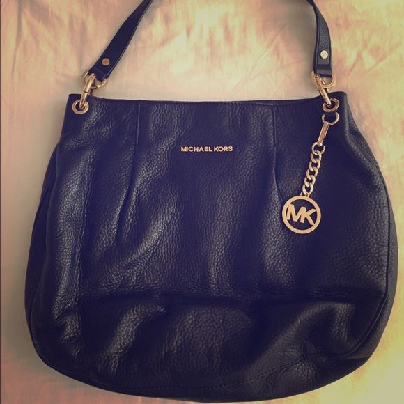 Michael Kors Black Purse Michael Kors. Black leather medium purse. Gold MK chain and gold accent strap. Black interior. Lightly used. In great condition!  Michael Kors Bags