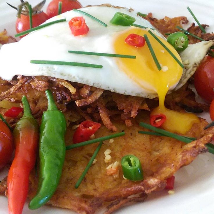 Kicking off the week with spicy, thin, crispy potato pancakes, eggs, garden tomatoes and chillies. It's going to be a wonderful week! #post @zimmysnook