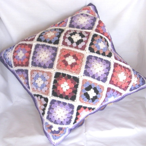 Crochet cushion in pink,lilac,blue,white navy. Unusual. Unique.Double sided. £30.00