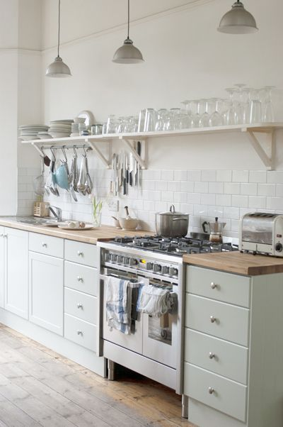 I love the subway tile and the idea of having no upper cabinets with just shelving...I just love it!!! I'm also a big fan of the butcher block counter tops!