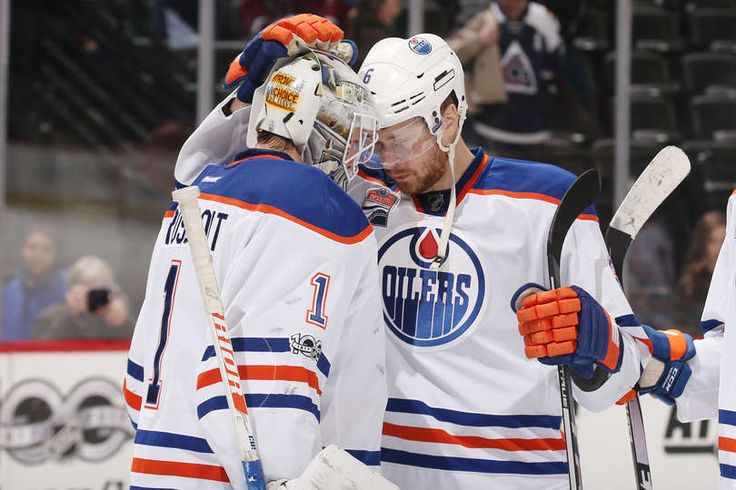 DENVER, CO - MARCH 23: Adam Larsson #6 of the Edmonton Oilers congratulates goaltender Laurent Brossoit #1 after a win against the Colorado Avalanche at the Pepsi Center on March 23, 2017 in Denver, Colorado. The Oilers defeated the Avalanche 7-4. (Photo by Michael Martin/NHLI via Getty Images)