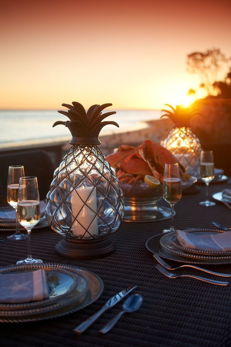 Planning a summer dinner party?  Shed a warm glow on your summertime table with the tropical Pineapple Hurricane Lantern, complete with handsome brass details.Summer Dinner