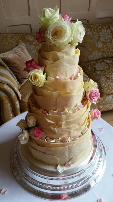 Chocolate wrap wedding cake! #weddingcake #chocolate #roses #whitechocolate #petals x