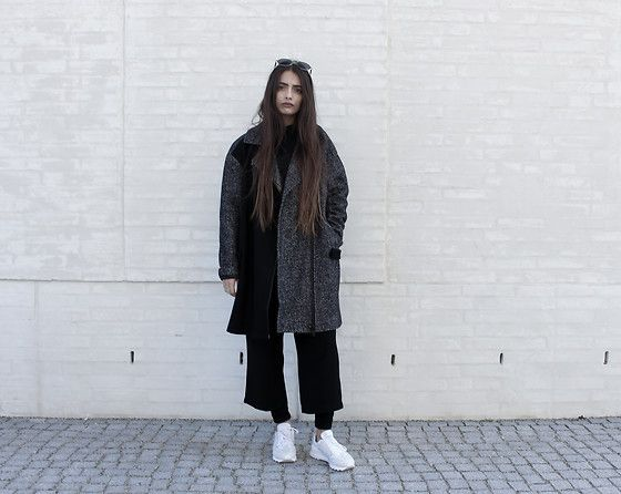 Get this look: http://lb.nu/look/8301677  More looks by Eleni Pashalidou: http://lb.nu/elenipa  Items in this look:  Calvin Klein Jeans Coat, Boohoo Culottes, Y 3 Sneakers, & Other Stories Sunglasses   #black #fashion #style #design #minimal #y3 #calvinklein