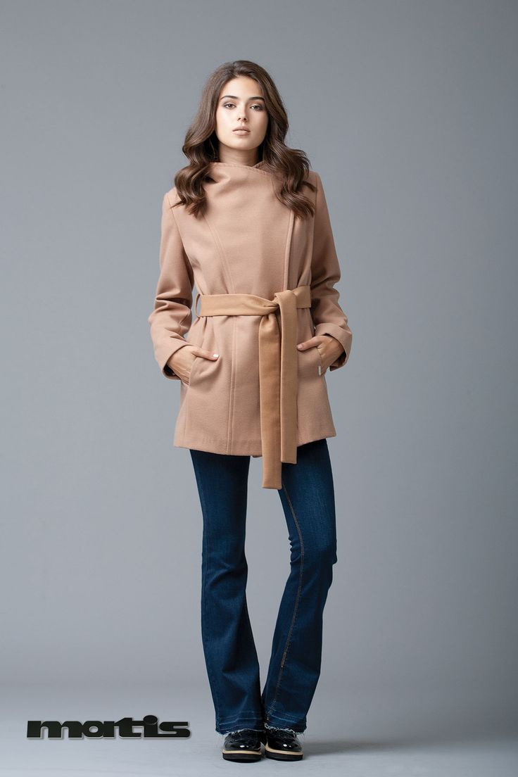 Cover up in style wearing a warm camel coat!