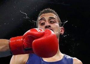 Algeria's Mohamed Flissi recovered from this big left to defeat Bulgaria's Daniel Asenov in their Men's Fly (52kg) Round of 16 Bout