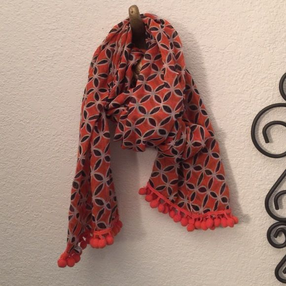 Super fun scarf! This is a great little orange scarf with a super fun pattern and pompon trim! Mudpie Accessories Scarves & Wraps