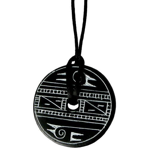 "Coal Pendant with Bird Design  Crafted by Artisans in Colombia  Measures 1-3/4"" in diameter and 1/8"" deep"