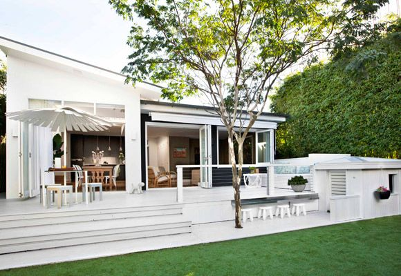 The new deck, painted Resene Alabaster, spans the width of the house. Outdoor setting from Parterre. The cubbyhouse has an alfresco eating area for the children to enjoy. Cubbyhouse stools from Ikea. Dog sculpture from Top3 by Design. Astroturf from A Synthetic Grass Specialists.