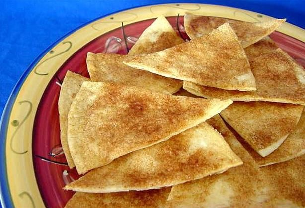 Cinnamon Tortilla Chips from Food.com... just made these and they are such a comfort food  Crunchy, sweet and addictive. I have suggested the 24 oz size package of tortilla, however, any size package may be used depending on the size and amount you would like to make.  Therefore, cooking times will vary.