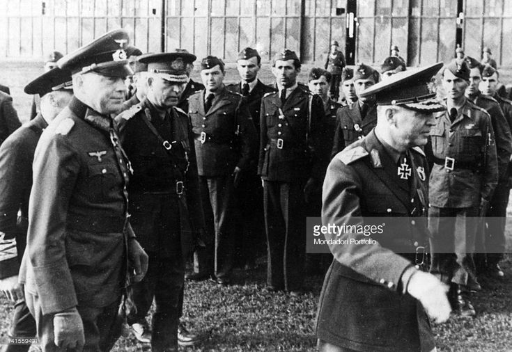 The head of the Romanian Government, Marshal Ion Antonescu, reviewing a guard of honour with German general Ewald von Kleist and the Romanian minister of war Costantin Pantazi. Ucraina, June 1942