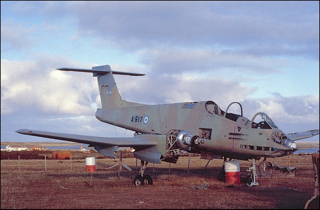 "Falklands War, Argentinian Pucara ground attack aircraft at Goose Green. The plane has lost to the ""memento collectors"".  ""Con Dios en el alma y un Halcón en el Corazón"""