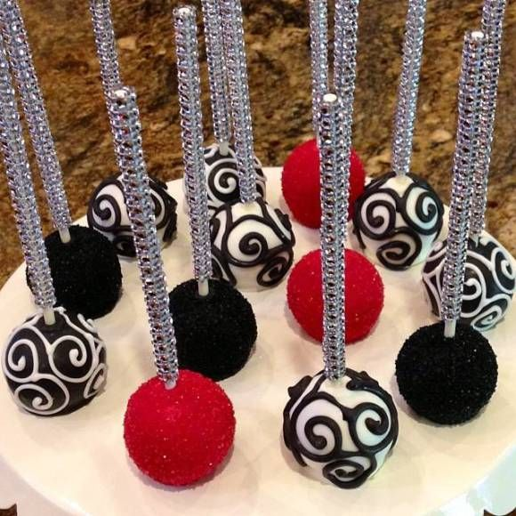 Black, red, and white cake pops with bling sticks