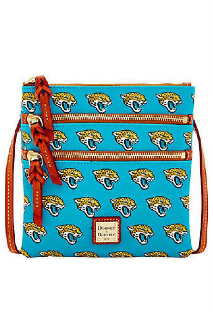 Take one for the team. Dooney & Bourke gives football fans a new reason to cheer with this NFL triple-zip crossbody. The allover Jaguars print on a teal background puts your loyalties on display, while the two exterior front zip pockets and main zip closure compartment provide plenty of space to tuck away tickets, cash, cards, and all your other game-day gear. From Dooney & Bourke. #ad