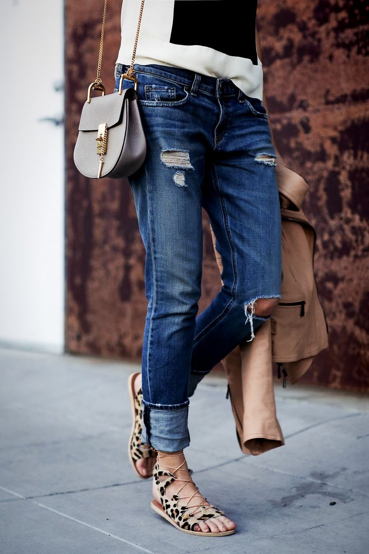 Lace up sandals + distressed denim.