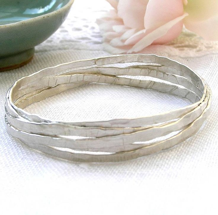 This beautiful, unusual bangle is handmade from a continuous, beaten length of silver.I make these bangles to a standard internal diameter of approx 6.4cm, but if you need a different size please get in touch via the 'ask the seller' button to discuss your specific requirements.The hammered texture gives the bangle a reflective quality that catches the light. The bangle comes beautifully gift boxed, at no extra charge. As I make each bangle to order, I usually suggest that you allow four…