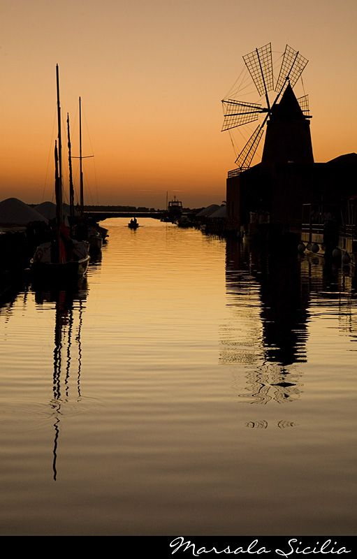 #Trapani #Windmill shows its beautiful shadow on the #salt pans at the #sunset  www.bebtrapanigranveliero.it